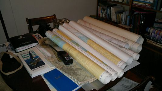 Lots of sea charts and books in addition to electronic navigational aids.