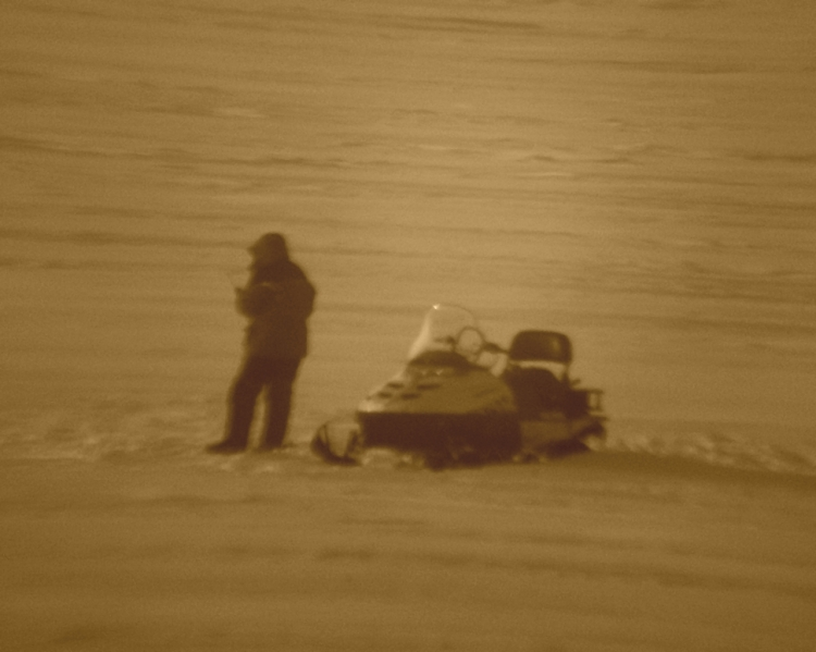snowscooter-on-ice-sepia